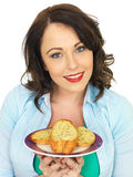Pretty Young Woman Eating A Slice of Garlic Bread Royalty Free Stock Photo