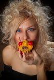 Young woman eating the tar Stock Photos