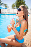 Pretty young woman is enjoying drink on vacation Royalty Free Stock Image