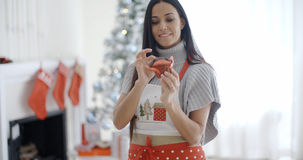 Pretty young woman enjoying her Christmas baking Royalty Free Stock Photos