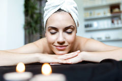 Pretty young woman enjoying massage at beauty spa. Royalty Free Stock Image