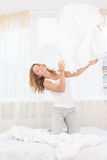 Pretty young woman enjoying morning time at her house lying in b Stock Photo