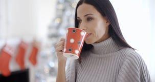 Pretty young woman enjoying a mug of coffee Stock Photos