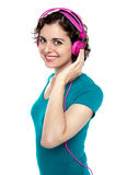 Pretty young woman enjoying music Royalty Free Stock Photo