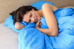 Pretty young woman enjoying a relaxing sleep stock image