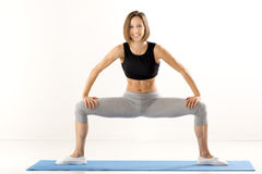 Pretty Young Woman Exercise Stock Photography