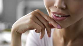 Pretty young woman face close up, beautiful lips, skincare lifting effect cream. Stock footage Stock Photography