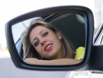 Pretty young woman face in  mirror Royalty Free Stock Photos