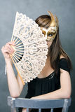 Pretty young woman with fan Royalty Free Stock Image
