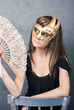Pretty young woman with fan Royalty Free Stock Photo