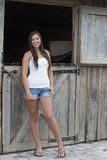 Pretty young woman on farm Royalty Free Stock Images