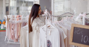 Pretty young woman in a fashion boutique Royalty Free Stock Images