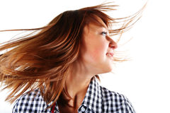 Pretty young woman flinging long hair into air. Isolated Stock Image