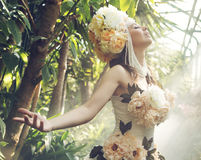 Pretty young woman with the flower hat Stock Photography