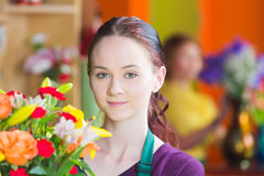 Pretty Young Woman in Flower Shop Royalty Free Stock Photo