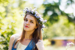 Pretty young woman with flower wreath on her head. Close-up summer portrait Stock Photography