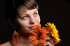 Pretty young woman with flowers stock photos