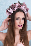 Pretty young woman with flowers in her hair Royalty Free Stock Photography