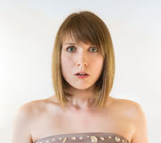 Pretty young woman is frightened Royalty Free Stock Image