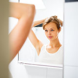 Pretty, young woman  in front of her bathroom Stock Photography