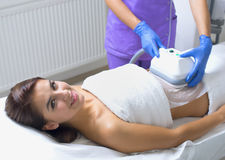 Pretty young woman getting cryolipolyse treatment Stock Images