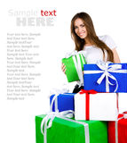 Pretty young woman with gifts Stock Images