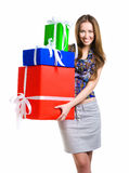 Pretty young woman with gifts Royalty Free Stock Image