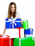 Pretty young woman with gifts Royalty Free Stock Photos