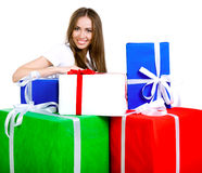 Pretty young woman with gifts Stock Photos