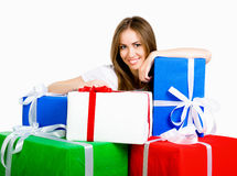 Pretty young woman with gifts Royalty Free Stock Photo