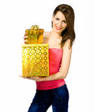 Pretty young woman with gifts Stock Image