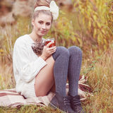 Pretty young woman. Pretty young girl drinks tea in retro clothes, enjoying autumn day Stock Images