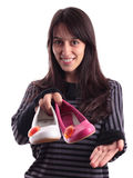 Pretty young woman giving shoes Stock Photography