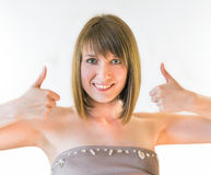 Pretty young woman giving thumbs up Stock Photo