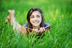Pretty young woman glasses lying Royalty Free Stock Photos
