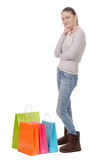 Pretty young woman goes shopping, isolated on white background Stock Images