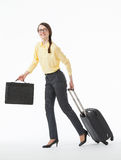 Pretty young woman going with a suitcase Royalty Free Stock Photos