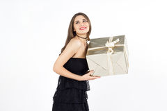 Pretty young woman with golden present box smiles and laughs Royalty Free Stock Photography