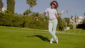 Pretty young woman golfer posing with the ball stock video footage