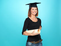 Pretty young woman in graduation outfit Royalty Free Stock Photos