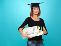 Pretty young woman in graduation outfit Stock Images