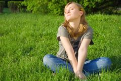 Pretty young woman on the grass Stock Image