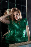 Pretty young woman in green fashion dress Royalty Free Stock Photos