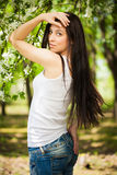 Pretty young woman in a green park. summer Royalty Free Stock Photos