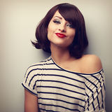 Pretty young woman grimacing with short black hair style in fash Stock Photos