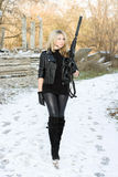 Pretty young woman with a gun Royalty Free Stock Photo