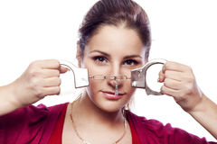 Pretty young woman with handcuffs Royalty Free Stock Images