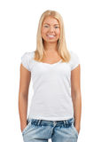 Pretty young woman with hands in pockets Royalty Free Stock Images