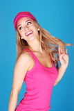 Pretty Young Woman Happy Go Lucky. Carefree young woman smiling with an over-the-shoulder look Stock Images