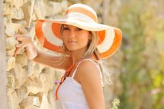 Pretty young woman with hat stock image